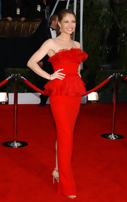Rebecca is stunning in this floor length strapless red number. The back slit and slender length are very alluring.