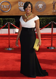 Niecy is supremely elegant in a black and white off-the-shoulder evening dress at the SAG Awards.