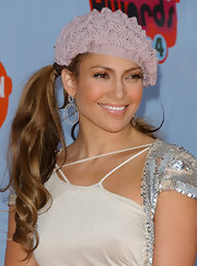 Jennifer Lopez was all smiles in this lilac beret.