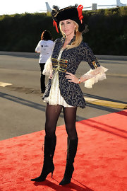 Camille Grammer was a sexy pirate in a mini dress and black suede lace up boots.