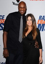 Lamar Odom was low-key at the Race to Erase MS Gala in his black shirt and gray plaid tie.