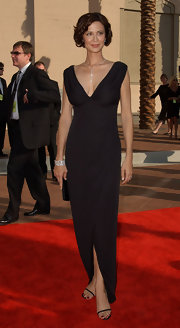 Catherine Bell was all about understated glamour at the Creative Arts Emmy Awards in a low-cut black evening dress.