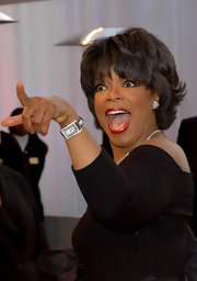 Oprah Winfrey accessorized with a stunning diamond watch at the 2002 Vanity Fair Oscar party.