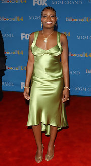 Fantasia Barrino opted for a pair of gold strappy heels to match her satin dress.