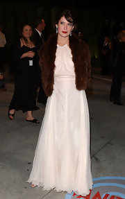 Lara Flynn Boyle layered a luxurious brown fur jacket over her evening dress for a totally glamorous look.