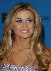 Carmen Electra paired her sparkling dress with marching purple gemstone earrings with delicate crystal detailing.