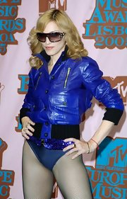 Madonna looked gutsy in a vibrant leather jacket over a body suit for the MTV Music Awards.