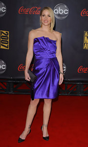 Christina rocks a purple strapless gown at the American Music Awards.