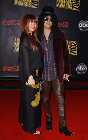 Slash teamed brown leather pants with a red velvet blazer and a striped button-down for his American Music Awards red carpet look.