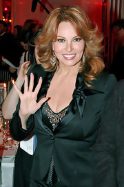 Raquel Welch wore a pair of crystal chandelier earrings at the Sidaction Benefit Party.