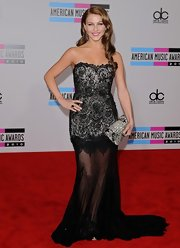 Julianna Hough carried a Judith Leiber Beaded Tassel clutch at the AMAs. The glimmering clutch has an Art Deco vibe.