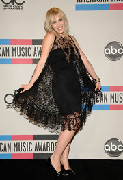 Natasha Bedingfield donned classic black pointy toe pumps with an over the top lace dress.