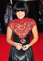 Lily Allen hit the 2010 Brit Awards in a unique leather dress and rounded bob.