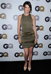 Cobie Smulders donned nude peep toe platforms with a ruched olive cocktail dress. A sophisticated updo completes the look.
