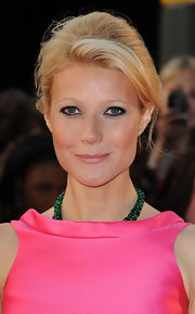 Gwyneth Paltrow looked amazing in her pink dress. She paired her look with a loose classic bun.