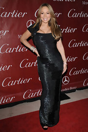 Mariah is definitely known for her honey brown layered locks. Her dress is so gorgeous that it might have suited her better to pull her hair back in an elegant bun. Either way she still looks stunning.