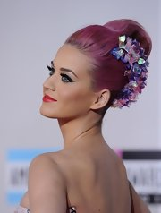 Katy Perry wore her pink tresses in a classic french twist with lots of volume and an iridescent ribbon hair accessory at the 2011 American Music Awards.
