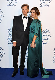 Colin Firth was dressed to the nines in a black suit and patent wingtips for the British Fashion Awards.