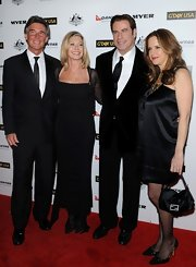 Olivia Newton-John posed with colleagues wearing a curve-hugging long gown at the 2011 G'Day USA Black Tie Gala.