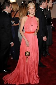 Isabel Clutch carried an exotic gold tasseled clutch to the 2011 Met Gala.