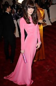 Michelle Monaghan looked exquisite at the Met Gala in a neon pink long-sleeve evening gown.