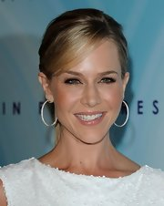 Julie Benz completed her sleek bun with silver and diamond encrusted hoop earrings.