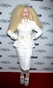 Lady Gaga covered up in a white Thom Brown skirt suit for the Glamour Women of the Year Awards.