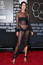 Erin Wasson left little to the imagination with this sheer dress paired over a bandeau bikini.