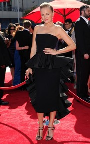 Malin Akerman looked very dressy at the Emmys in a black strapless dress with frilly peplum detailing.