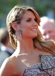 Heidi Klum styled her long locks in a partially braided feathery 'do for the Emmys.