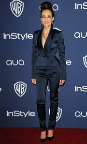 Maggie Q attended the InStyle/Warner Bros. Golden Globes party wearing a sharply tailored navy pantsuit.