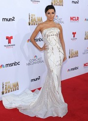 Eva Longoria put on a regal display in a gold-embroidered white strapless gown by Gabriela Cadena at the NCLR ALMA Awards.