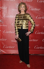 Jane Fonda matched a metallic gold clutch with her jacket for total shine.
