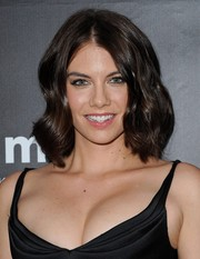 Lauren Cohan attended the amfAR Inspiration LA Gala wearing high-volume, center-parted waves.