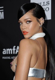 Rihanna brightened up her pout with an orange hue.