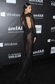 Alessandra Ambrosio stole the limelight in a see-through beaded gown by Zuhair Murad during the amfAR Inspiration LA Gala.