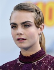 Cara Delevingne caught eyes with her finger-wave ponytail at the MTV Movie Awards.