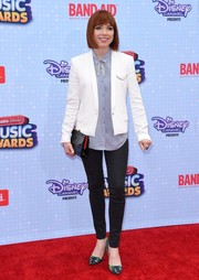 Carly Rae Jepsen layered a white tux jacket over a blue button-down for her Radio Disney Music Awards look.