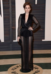 Lily Collins showed her seductive side in a sheer mesh wrap gown by Zuhair Murad during the Vanity Fair Oscar party.