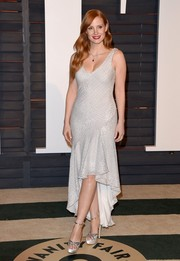 Jessica Chastain sealed off her look with chic Jimmy Choo platform sandals.