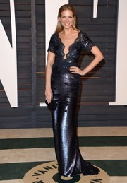 Petra Nemcova arrived at the Vanity Fair Oscar Party in a stunning lace embellished gown in a metallic fabric.
