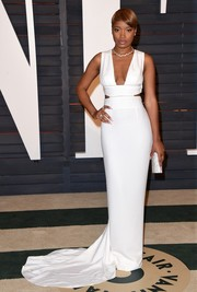 Keke Palmer went for an all white gown with a deep plunge and cheeky cutout sides at the Vanity Fair Oscar Party.
