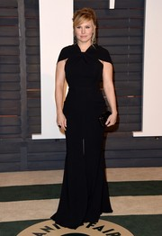 Kristen Bell flaunted her curves in a figure-hugging black Talbot Runhof gown at the Vanity Fair Oscar party.