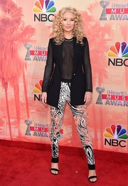 Iggy Azalea sealed off her eye-catching look with a pair of mixed-print leggings by Roberto Cavalli.