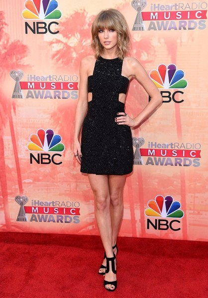 Taylor Swift was fun and chic in her '60s-glam Kaufmanfranco cutout LBD at the iHeartRadio Music Awards.