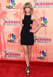 Taylor Swift's black Tamara Mellon strappy sandals perfectly complemented her dress.