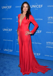 Michelle Rodriguez was a lady in red with her long-sleeved gown that featured side cut-outs, a thigh-high slit, and floor-skimming train.