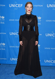 Bond actress Lea Seydoux fittingly wore a high neck sheer Louis Vuitton gown- as the French star was just named the new face of the brand- and finished her look with a bodysuit under the Victorian-inspired number.