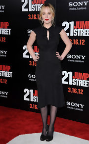 Dakota Johnson wore this black LBD with a ruffled keyhole for the '21 Jump Street' premiere.