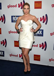 Ashley Benson added sparkle to her little white dress with black glittery pumps.